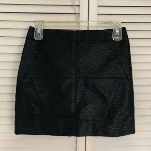High-waisted mini leather skirt